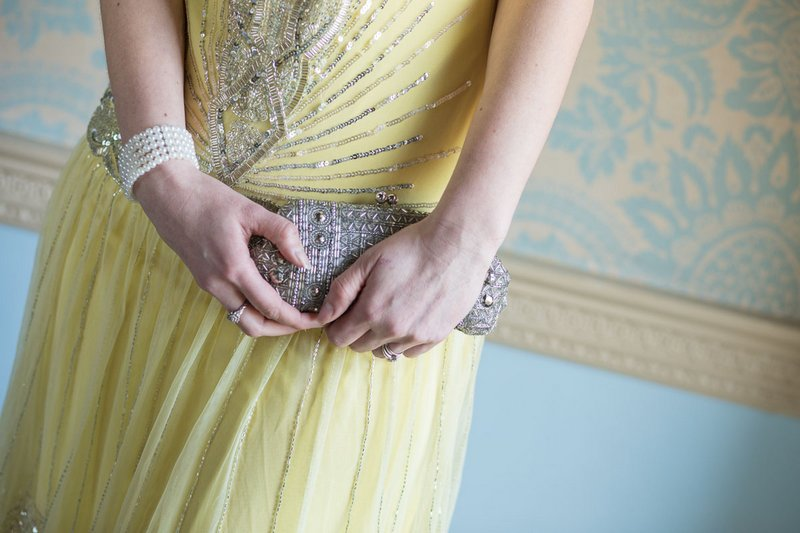 Bridesmaid holding clutch bag