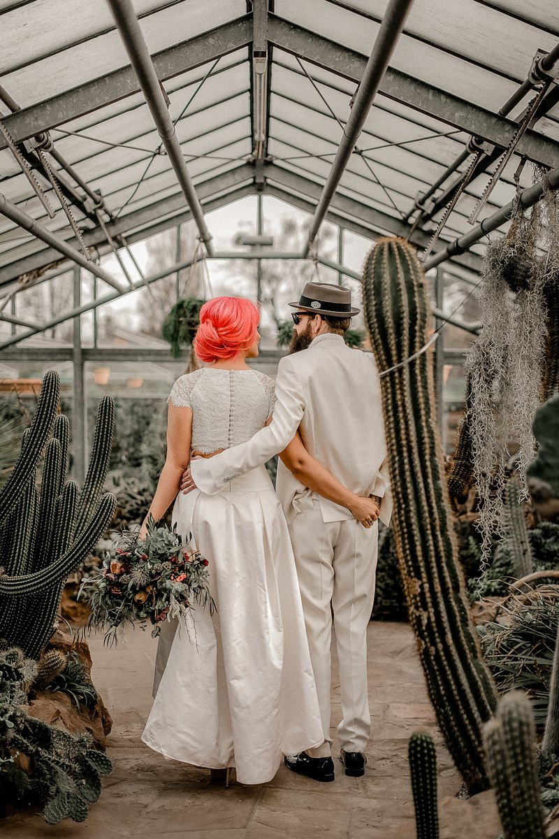 Bride and groom in greenhouse of cactuses