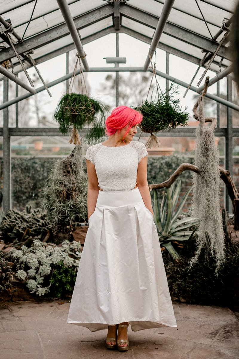 Bride with pink hair in greenhouse full of cactuses