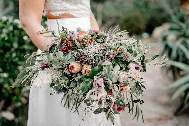 Bride holding wild bouquet