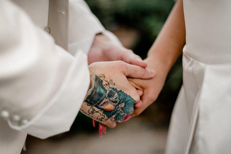 Tattoo on groom's hand