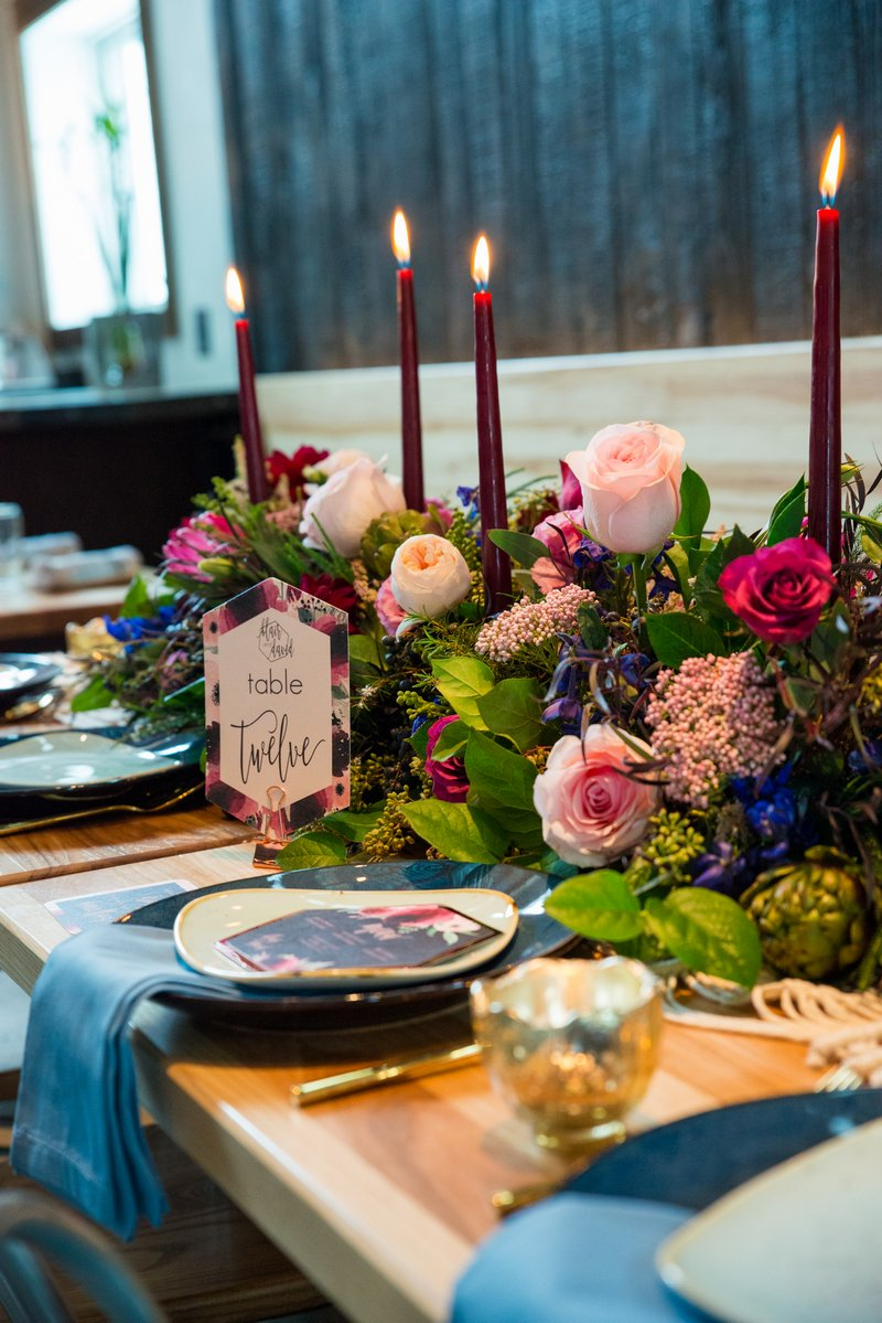 Winter wedding table with colourful floral centrepiece