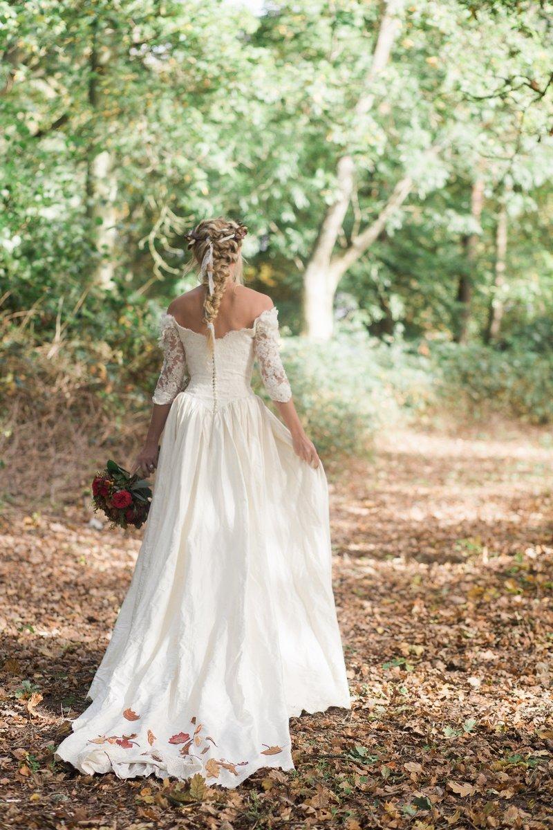Bride walking through woodland