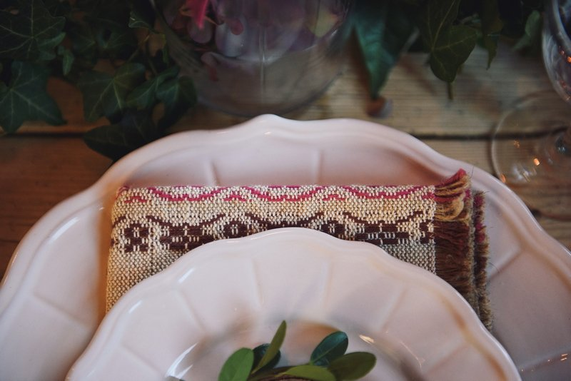 Woven napkin under wedding plate