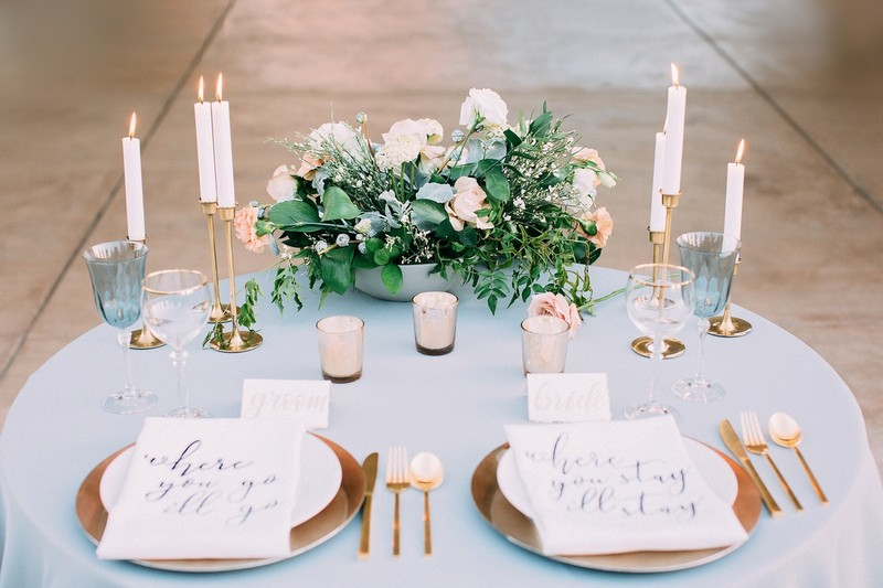 Bride and groom wedding place settings