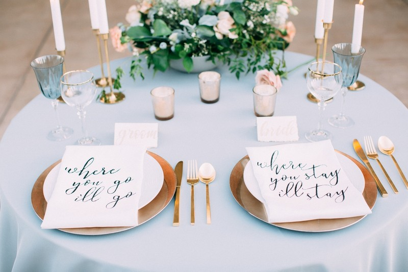 Messages on bride and groom wedding place settings