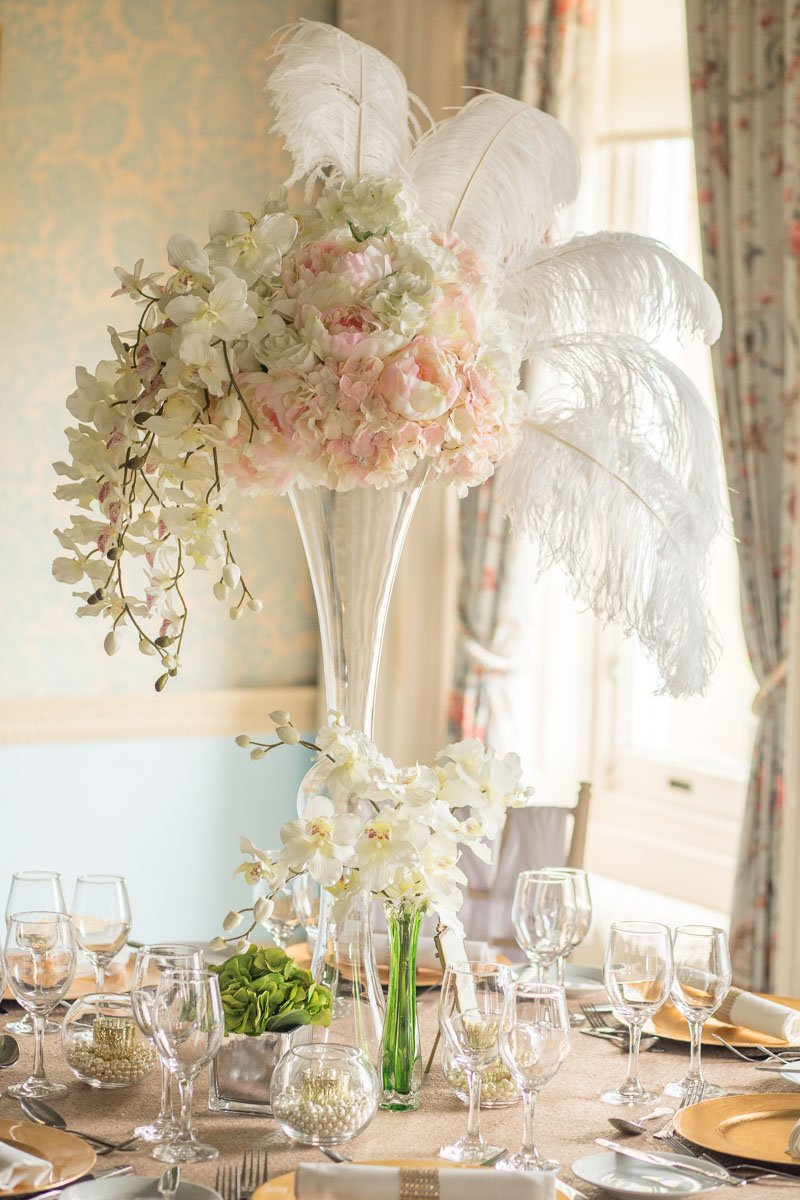 Floral wedding table centrepiece with feathers