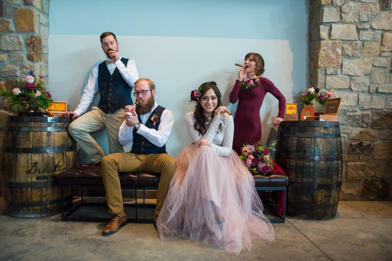 Bridal party posing with cigars at Breckenridge Distillery