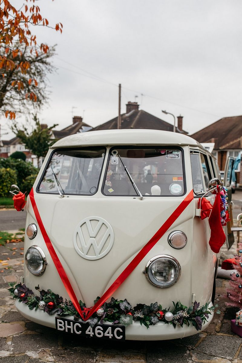 VW van with red ribbon on front