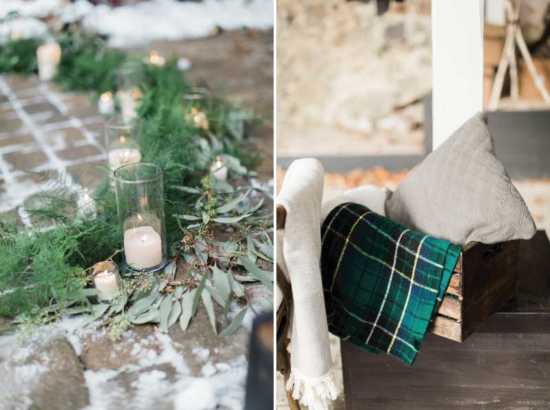 Candles and foliage on ground and box of blankets for winter wedding