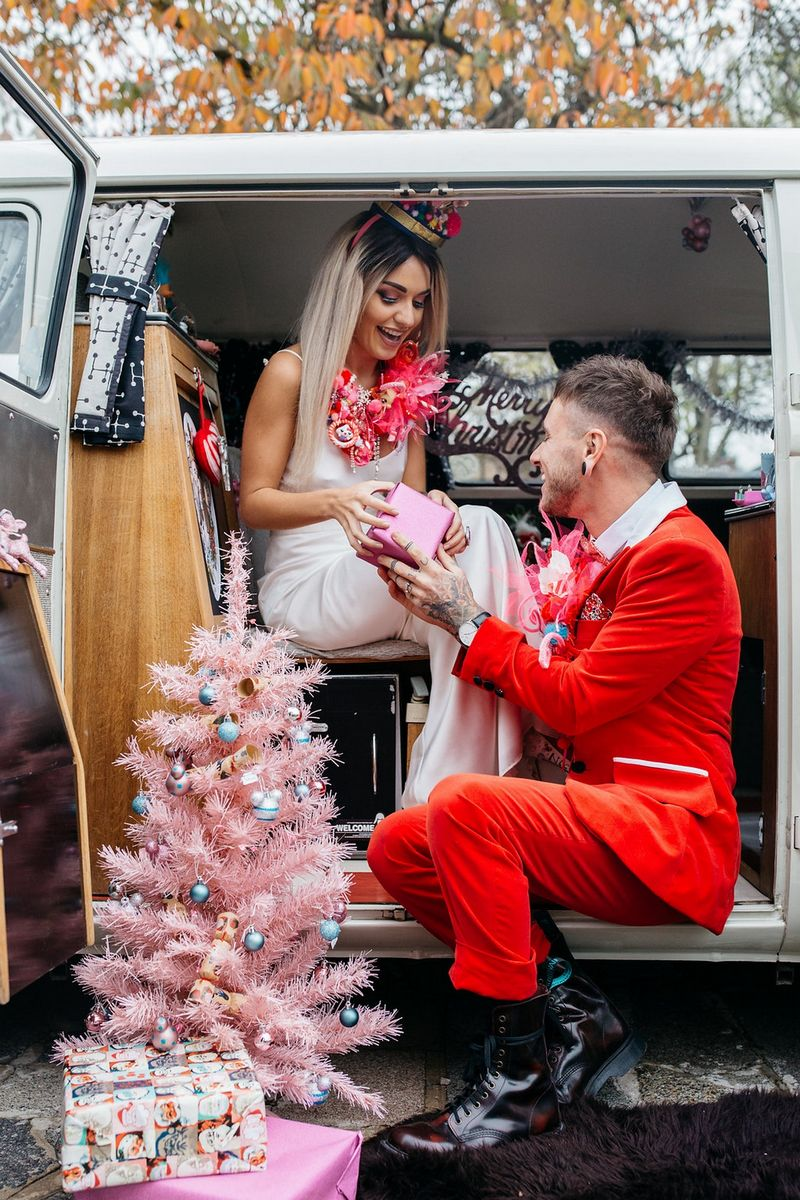Bride handing groom Christmas present from VW van