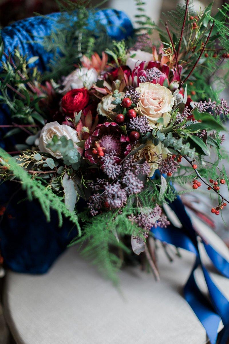 Winter wedding bouquet with burgundy flowers
