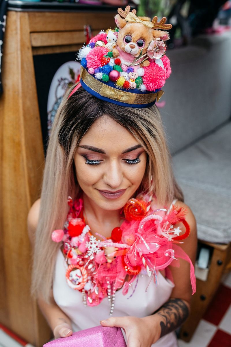 Bride wearing Christmas pom pom hat and necklace made from kitsch toys and ribbons