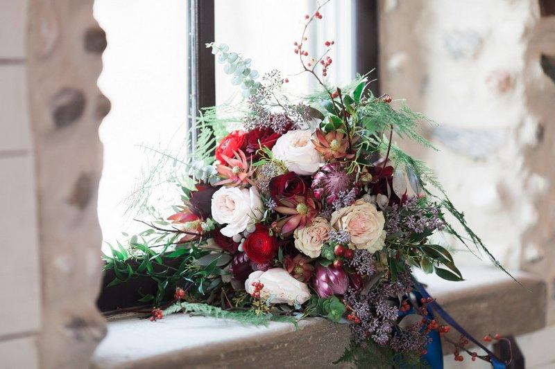 Winter wedding bouquet on window ledge