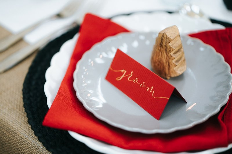 Red groom name place card