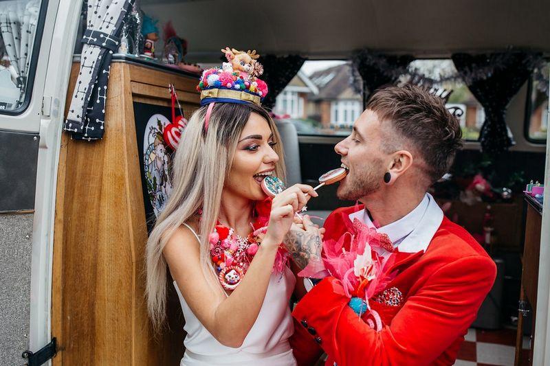 Bride and groom eating lollipops