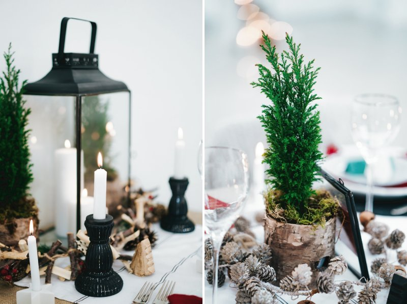 Lanterns, candles and fir tree on wedding table