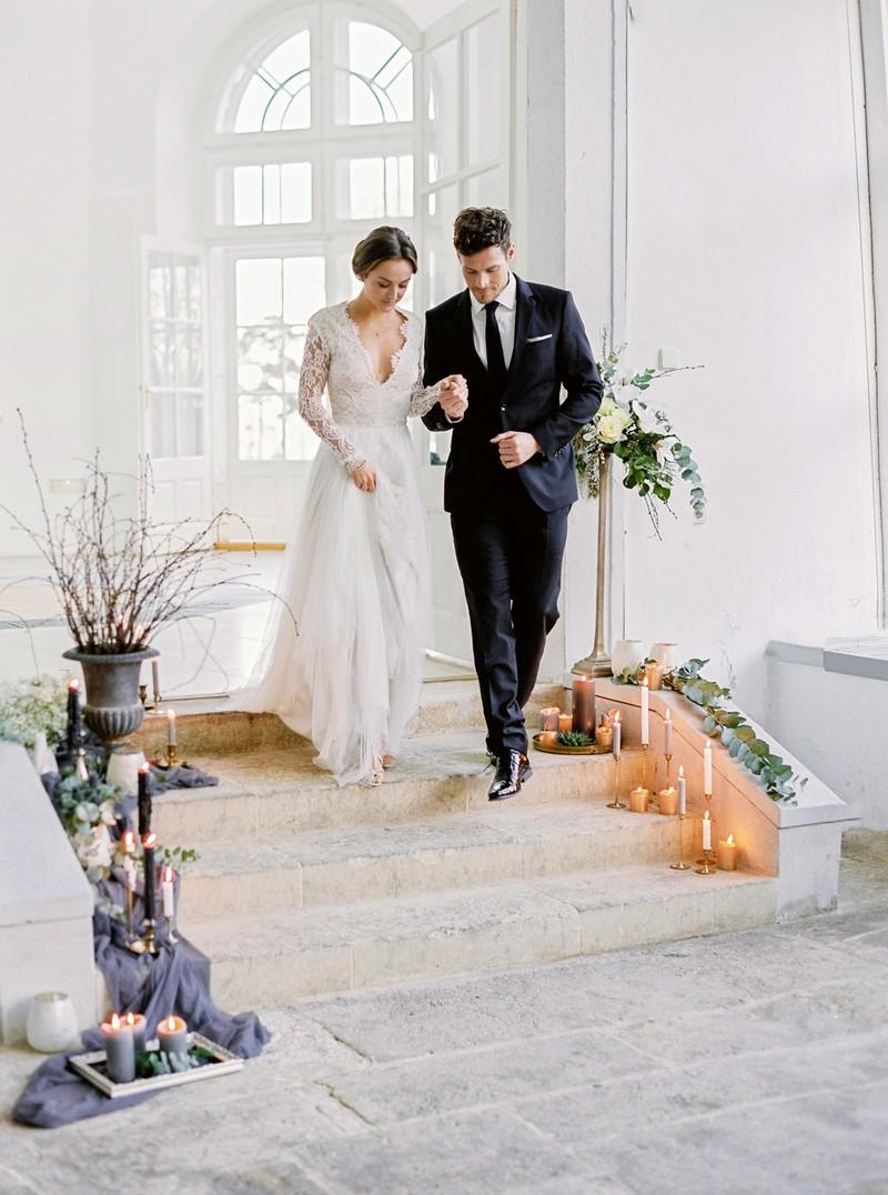 Bride and groom walking down steps