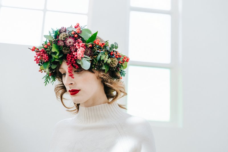 Bride wearing crown of green foliage and red berries