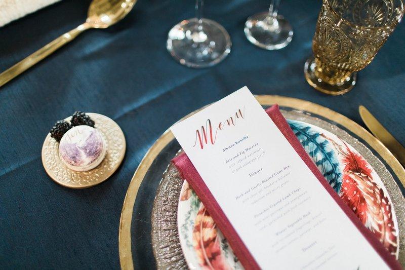 Winter wedding menu on burgundy napkin