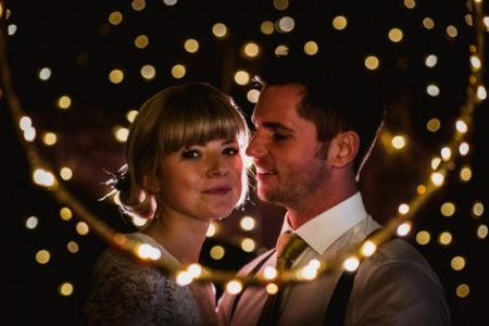 Bride and groom surrounded by fairy lights - Picture by Robin Goodlad Photography