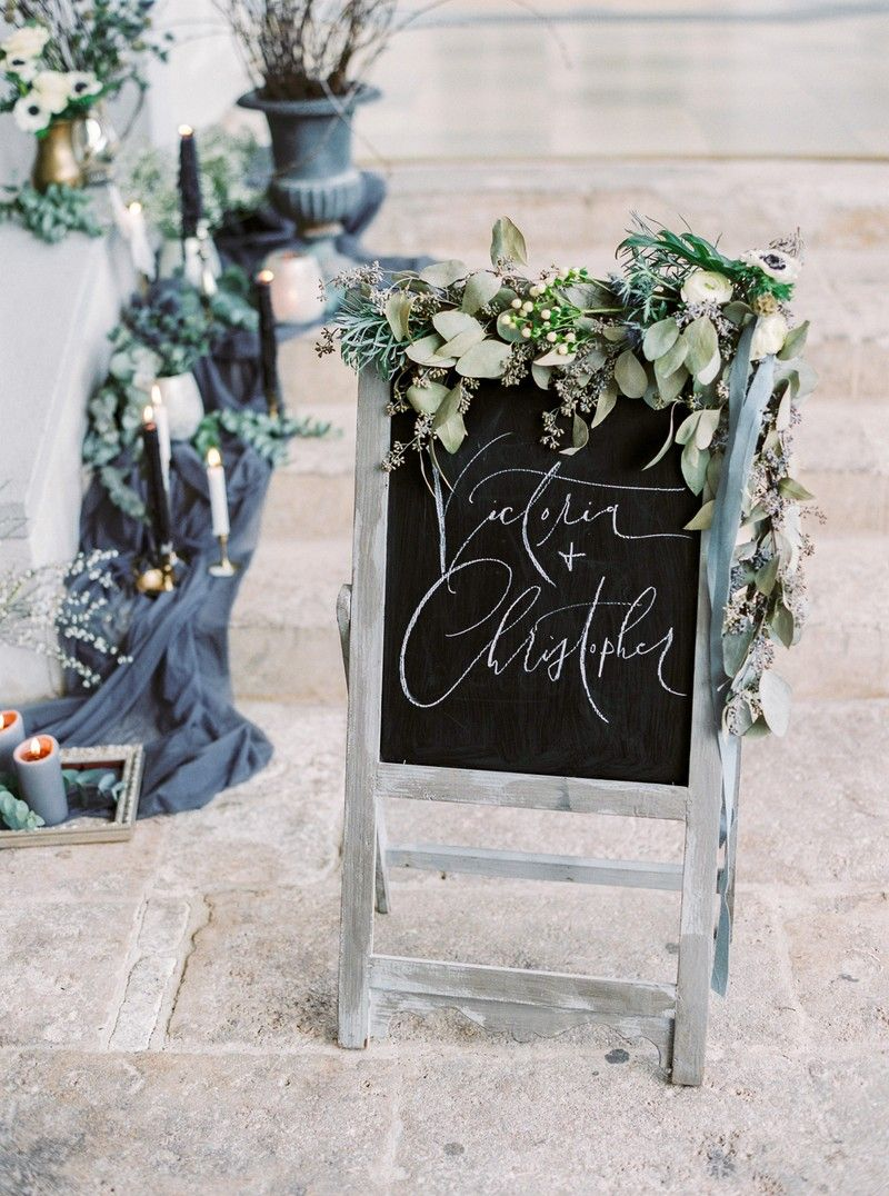 Wedding chalkboard sign decorated in foliage