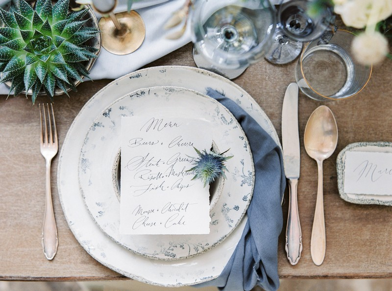 Wedding place setting with hand-written menu and grey napkin