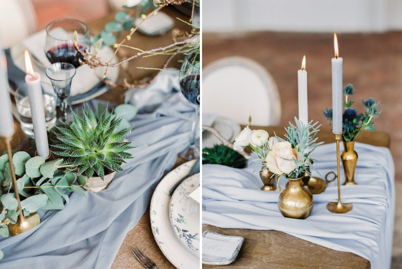 Small pot plant and candles on grey wedding table runner