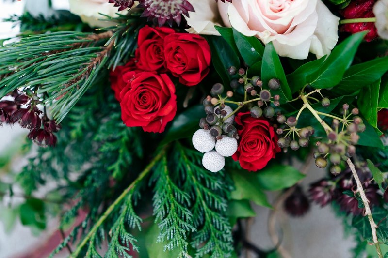 Red roses and foliage of wedding bouquet