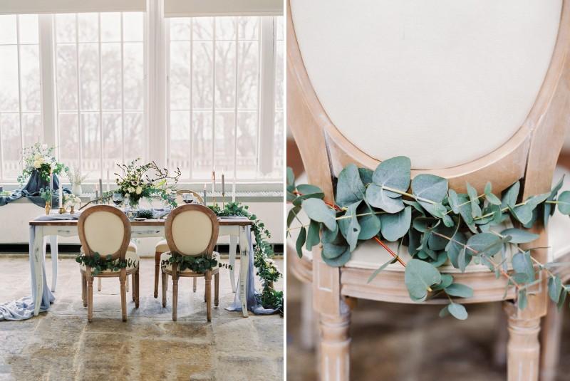 Eucalyptus foliage on back of wedding chair