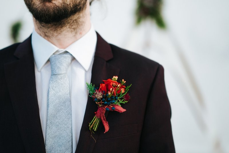 Groom wearing winter wedding buttonhole