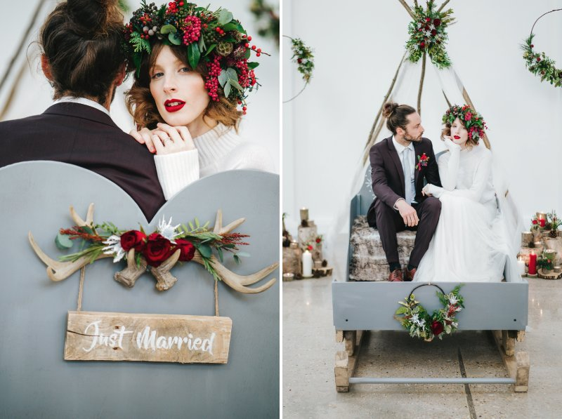 Bride and groom sitting on sleigh with Just Married sign on back