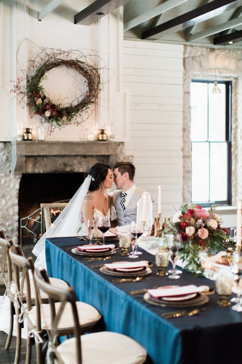 Bride and groom sitting at wedding table