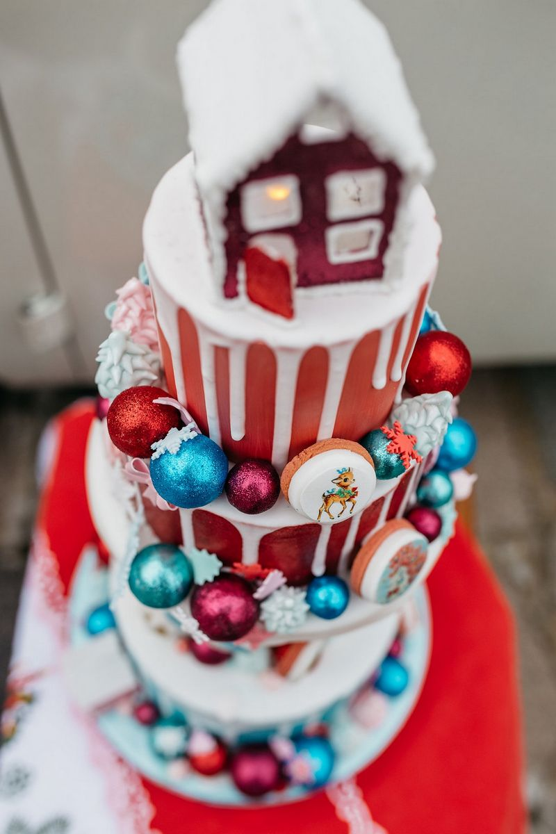 Red Christmas drip wedding cake with house topper