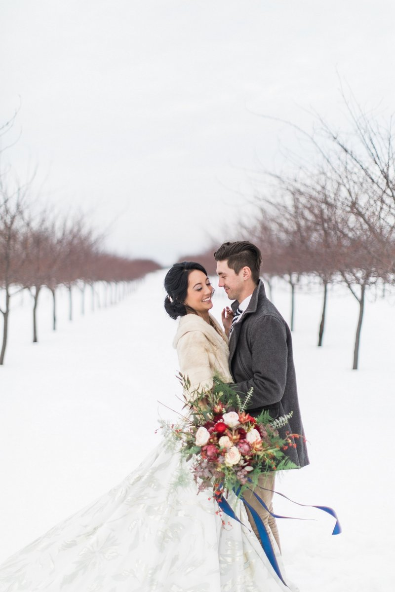Bride and groom in snow