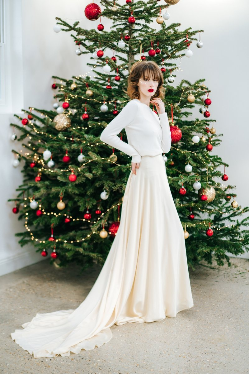 Bride standing in front of Christmas tree