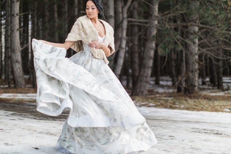 Bride twirling in snow