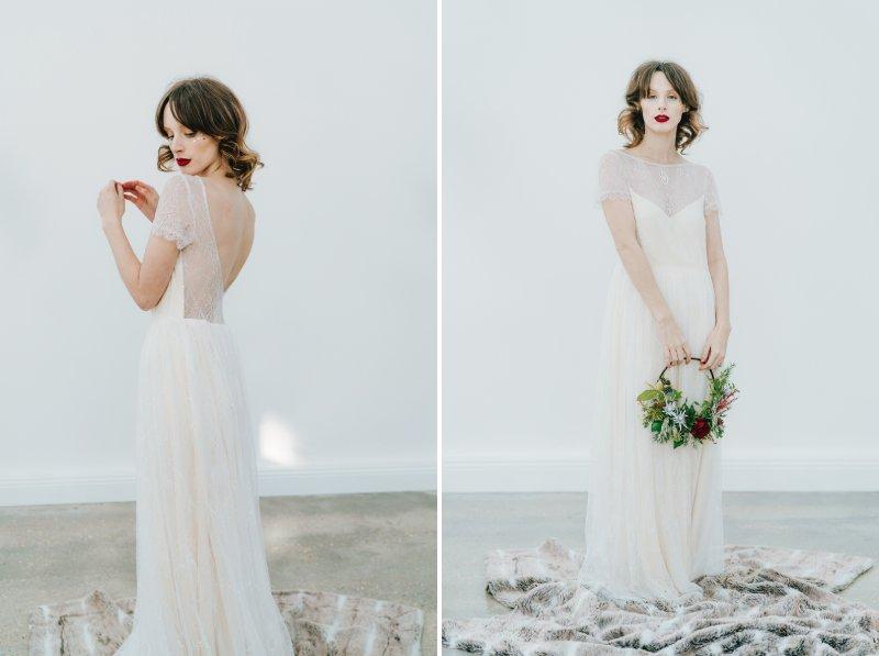 Bride holding winter floral hoop
