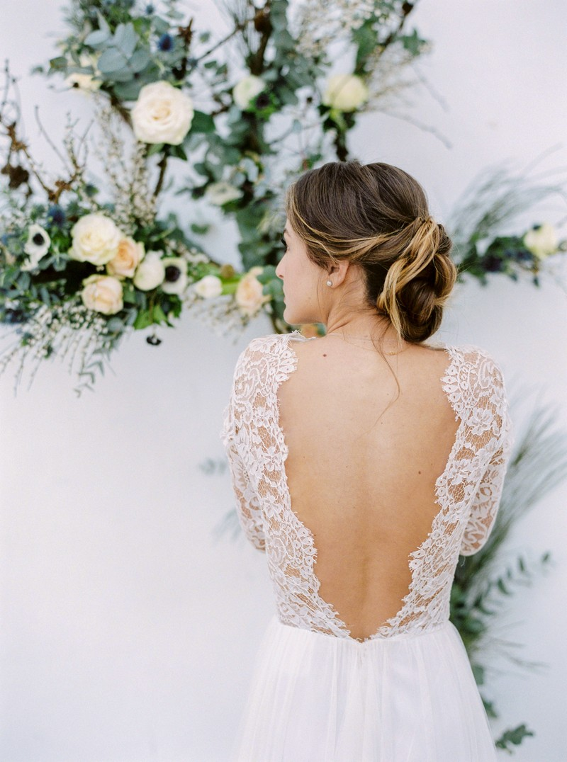 Bride showing open back of wedding dress