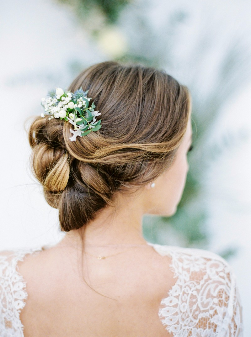 Winter foliage in bride's updo hairstyle