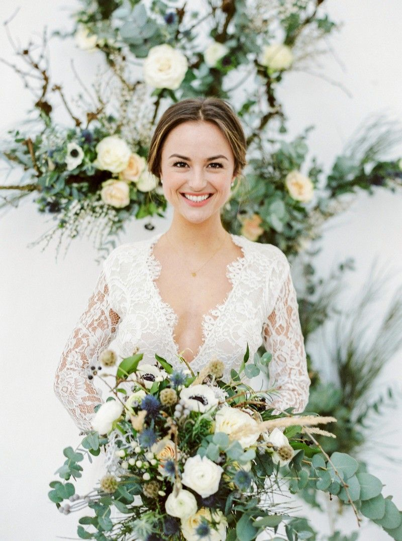Smiling bride holding winter wedding bouquet