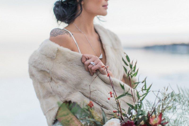 Bride wearing winter fur shrug