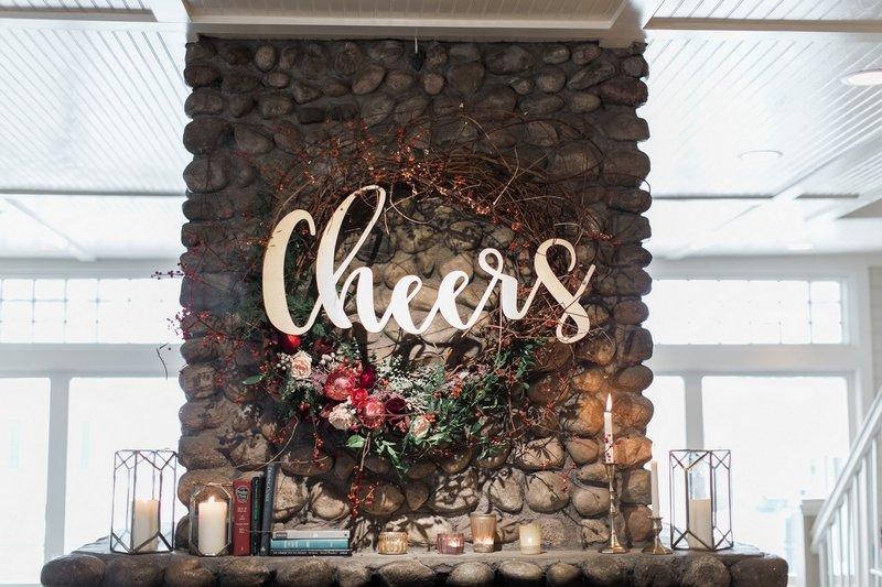 Cheers sign and wreath on wall