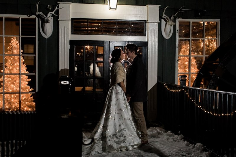 Bride and groom outside Willowbrook Mill, Michigan, at night