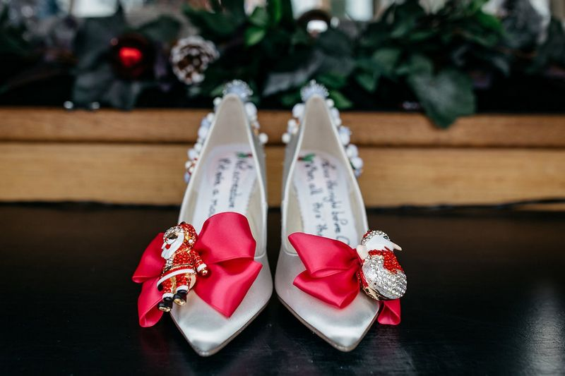 Christmas wedding shoes with red ribbon and Santa and snowman figured on front