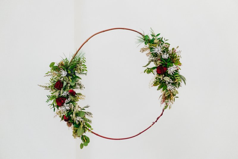 Hoop with green foliage and red flowers