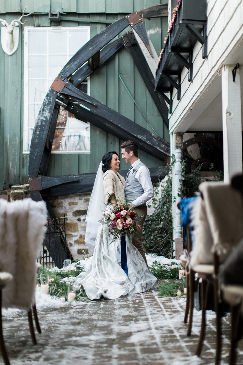 Bride and groom by wheel of Willowbrook Mill, Michigan