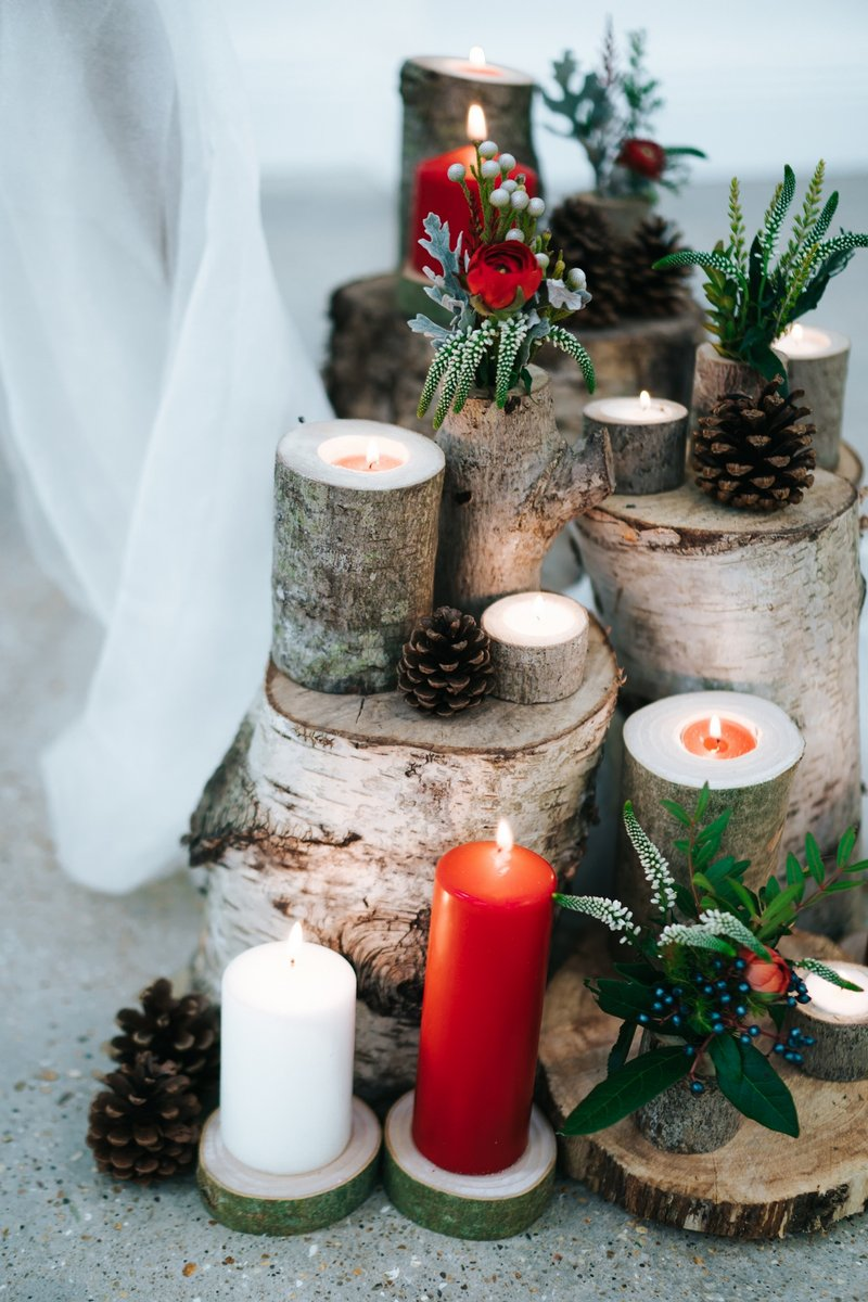 Logs and candles winter wedding display