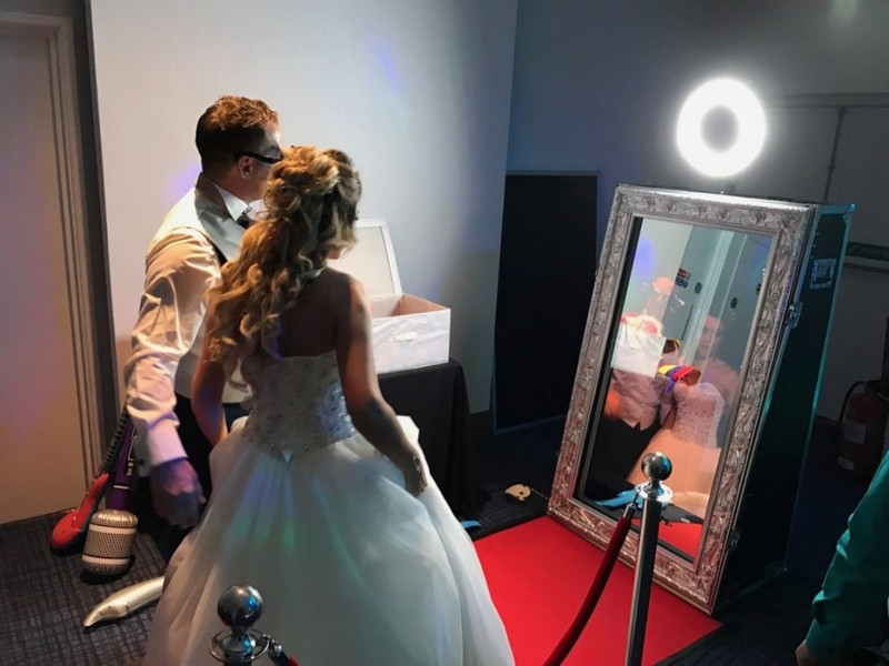 Bride and Groom Looking in Magic Mirror
