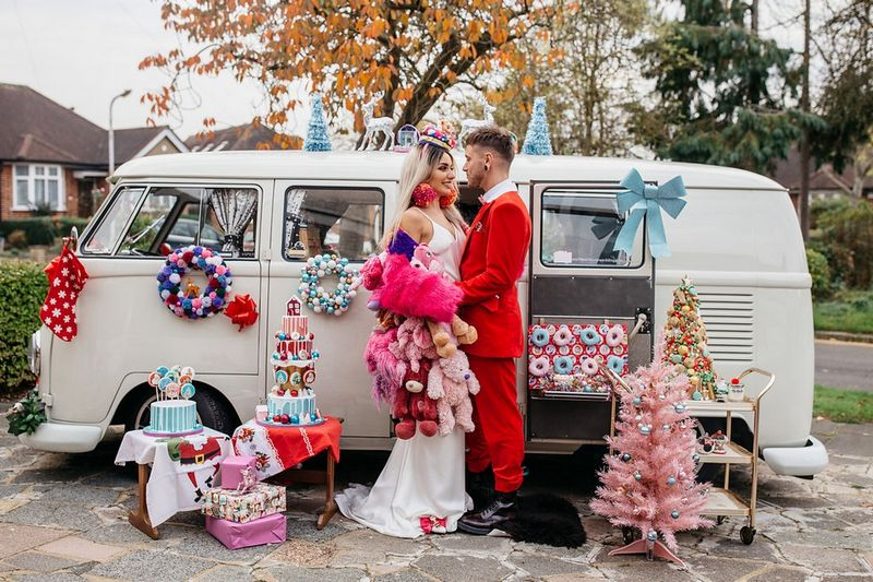 Bride and groom outside VW van with 'Merry Kitschmas' wedding styling